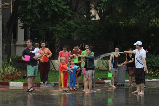 Boys splashing folks during Songkrat festival