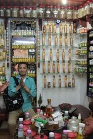Ryo smelling something in the perfumery