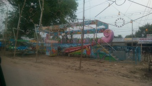 A ride preparation for a festival - very mechanical operation